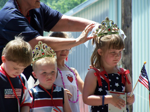 "Crowning of ""Litle Miss and Mr. Firecracker"" at Hebron's Fourth of July Celebration."